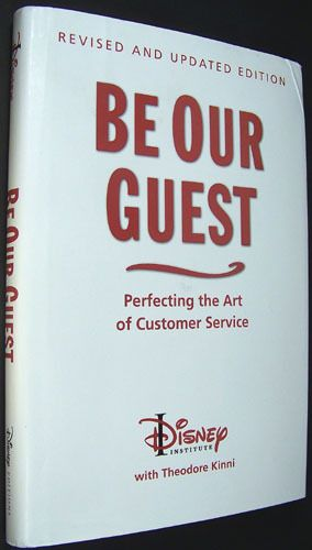 """Front cover of the book, """"Be Our Guest"""" from the Disney Institute."""