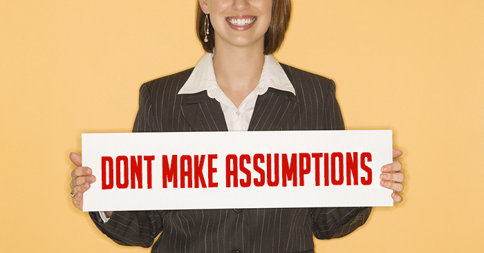 """Women holding a sign that says """"dont make assumptions"""""""